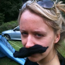 Lucy Robinson with a moustache.